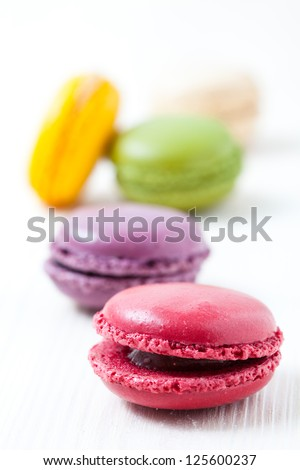Close-up of colorful macaroons on light background
