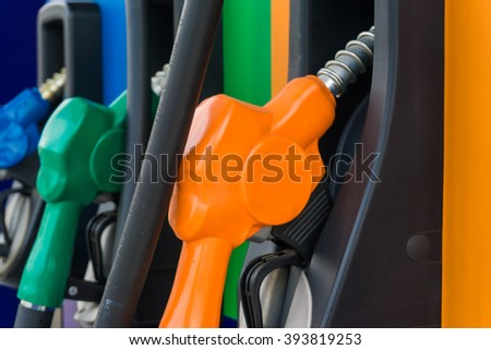 Close up of colourful fuel pumps at a gas station.