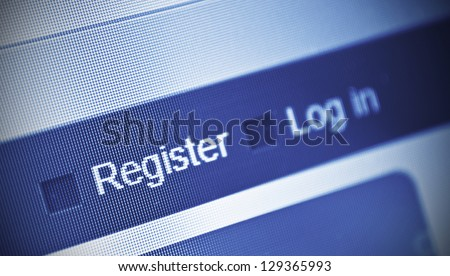 close-up of computer screen and register button