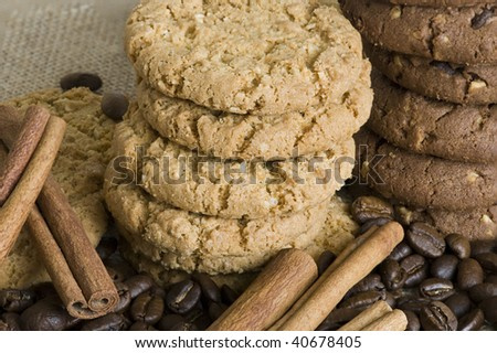close up of cookies and cinnamon sticks
