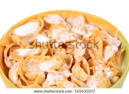Close up of corn flakes with milk. Whole background.