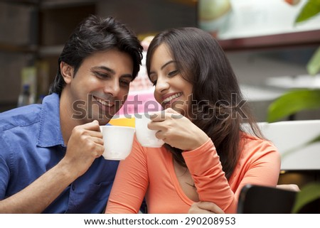 Close-up of couple enjoying their tea together in shopping mall
