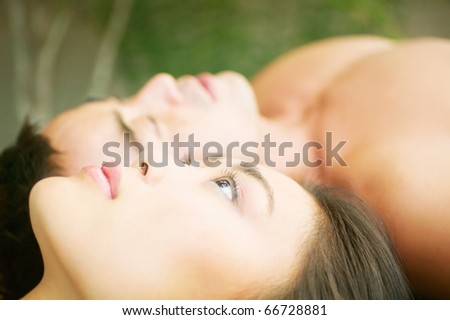 Close up of couple laying down