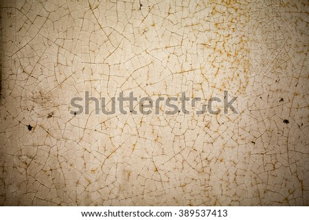 Close-up of cracked paint texture, light brown
