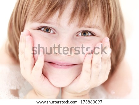 close up of cute young girl face in bath