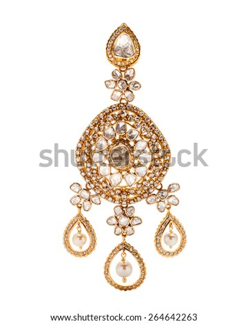 Close up of diamond earring with many stones and diamonds on white background