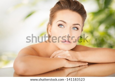 close up of dreaming woman lying on the mirror