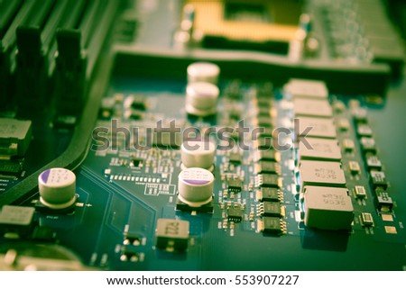 Close up of electronic circuit board background with processor computer blue technology background