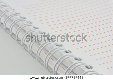 close-up of empty spiral notebook