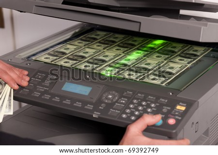 Close up of fake money on copy machine in office