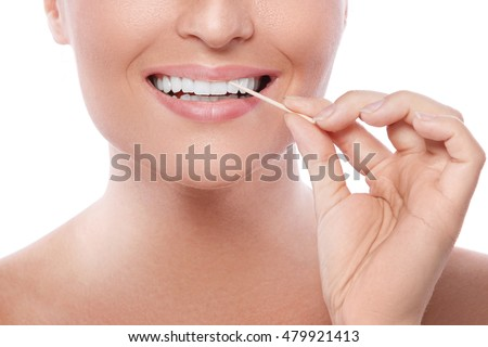 Close up of female teeth and toothpick