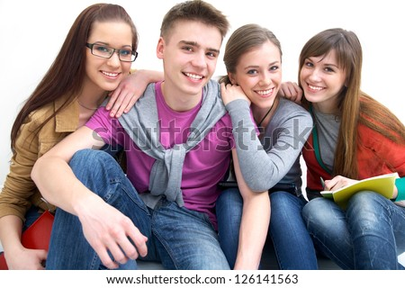 Close-up of four teenagers laughing and looking at camera