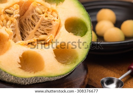Close up of fresh and sweet tropical fruit, melon or cantaloupe in round shape with selective focused point