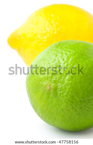 Close up of fresh green lime and lemon isolated on white background