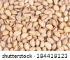 Close up of fresh pistachios. Whole background. - stock photo