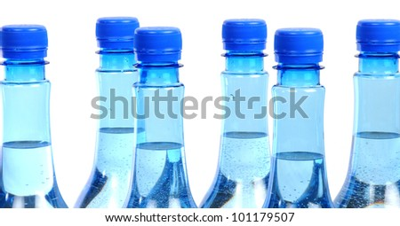 close up of gas water bottles on a white background