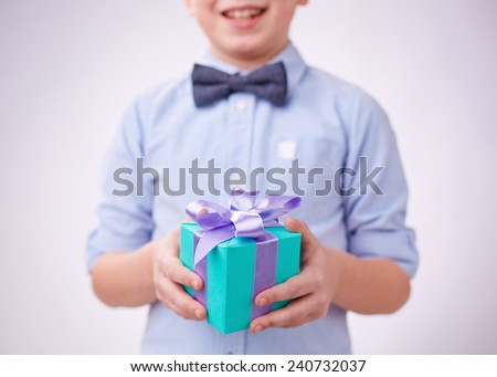 Close-up of gift box on hands of a boy