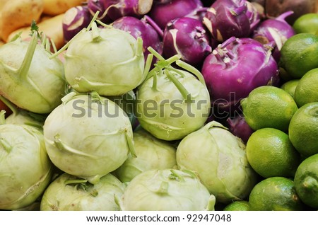 Close up of green and red kohlrabi on market stand