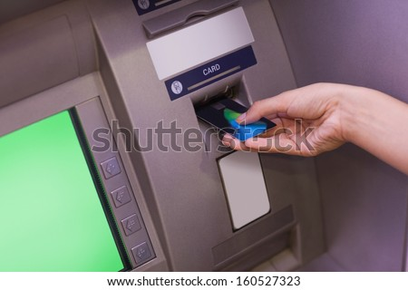 Close up of hand withdrawing cash at an ATM