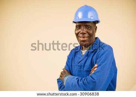Close up of happy african construction worker, plumber, electrician, handyman
