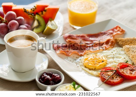 Close up of healthy continental breakfast with fresh fruit and ground coffee.