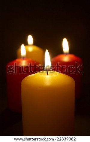 close up of lighted candles on black background