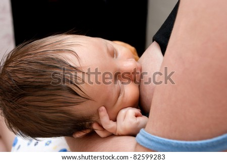 Close up of little baby breast feeding