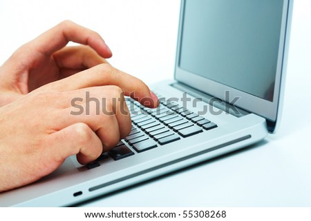 Close-up of male hand over keyboard of laptop during computer work