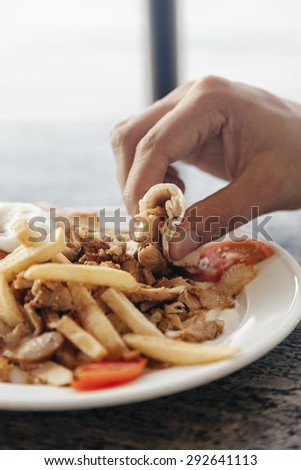 Close Up Of Men's Hand Taking Tandoori Chicken