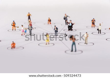 close up of miniature people with social network diagram