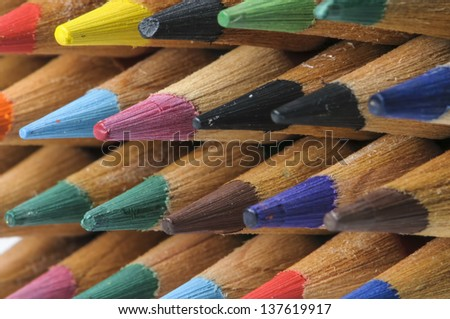 Close up of multicolored pencils row