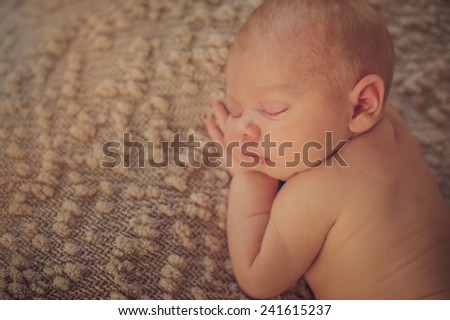 Close up of Newborn baby on Hands