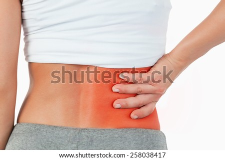 Close up of painful female back against a white background