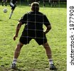 close up of people at sport, silhouette of a goalkeeper shot from behind - stock photo