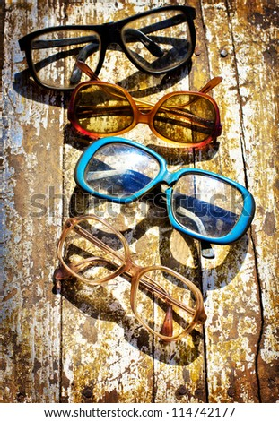 Close-up of retro glasses against vintage background/