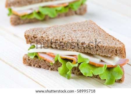 Close up of sandwich on wooden table top