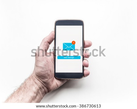 Close up of smartphone with Email app interface on screen holding in man's hand.