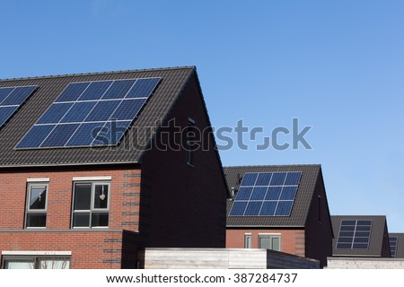 Close up of solar panels on family houses producing alternative energy