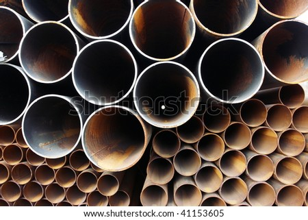 Close-up of steel high-pressure pipes bunch in warehouse