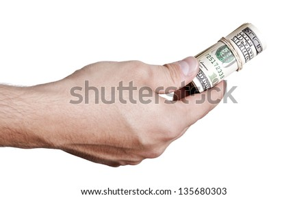 Close up of the right hand of an adult man holding a rolled up cluster of 100 US$ money notes wrapped in a rubber band, in the gesture of giving. Isolated on white background.