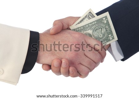 close-up of the transfer of money from hand to hand on a white studio background