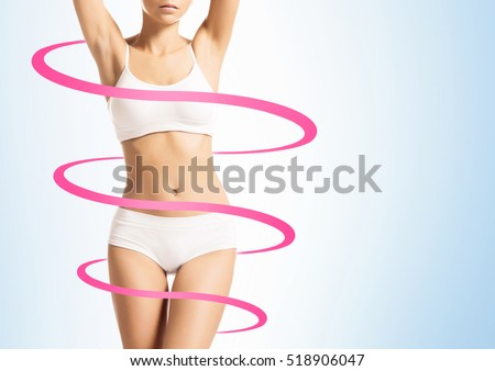Close-up of thin and beautiful female body. Weight loss, fat burn, sports, exercising concept. Red arrows.