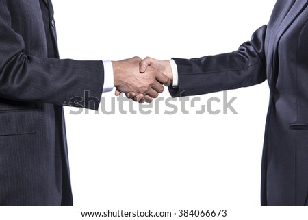 Close-up of two businessman shaking hands over white background.