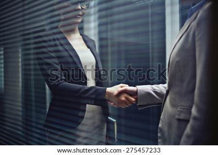 Close-up of two businesswomen handshaking