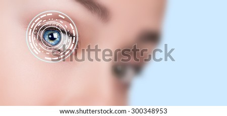 Close up of woman eye with digital icons