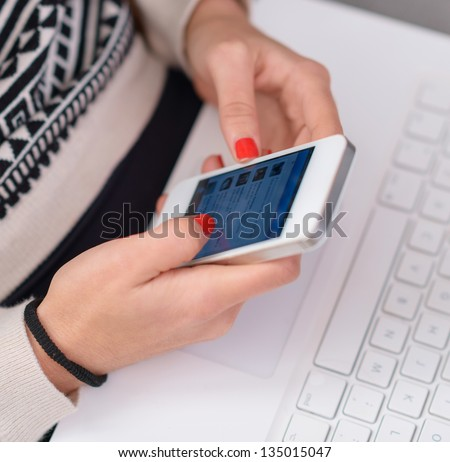 Close-up Of Woman's Hand Holding Cell Phone, Indoors