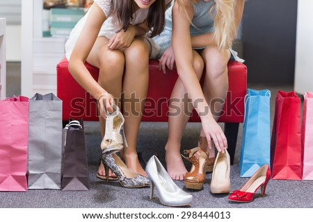 Close up of women trying on shoes in shoe shop