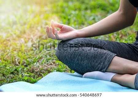 close young girl doing yoga lotus stock photo 590455382
