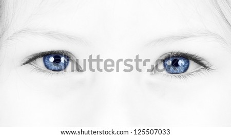 Close up on a beautiful blue eyes of a young girl