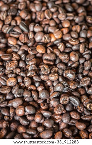 Close up pattern black roasted coffee bean texture and background